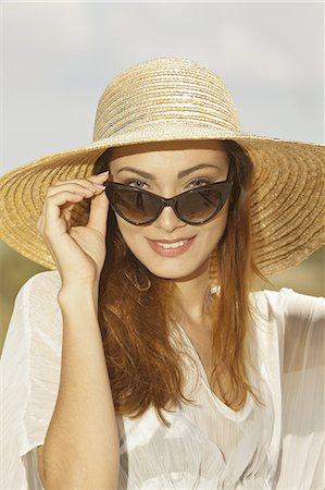 sunglasses - woman at beach wearing sunglasses Stock Photo - Premium Royalty-Free, Code: 6106-07351059