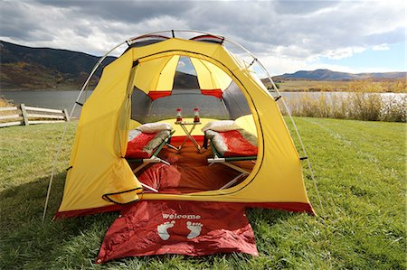 Tent set up at lakeside campsite in fall season Stock Photo - Premium Royalty-Free, Code: 6106-07351000