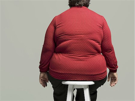 fat lady sitting - Obese woman on chair Stock Photo - Premium Royalty-Free, Code: 6106-07351011