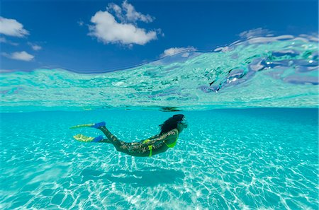 Female snorkeler in shallow tropical lagoon. Stock Photo - Premium Royalty-Free, Code: 6106-07454949