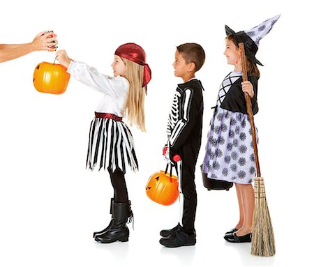 Halloween: Kids Waiting for Trick or Treat Candy Stock Photo - Premium Royalty-Free, Code: 6106-07455285