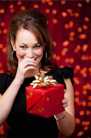 present wrapped close up - Christmas: Giggling Woman Offers Present Stock Photo - Premium Royalty-Free, Code: 6106-07455288