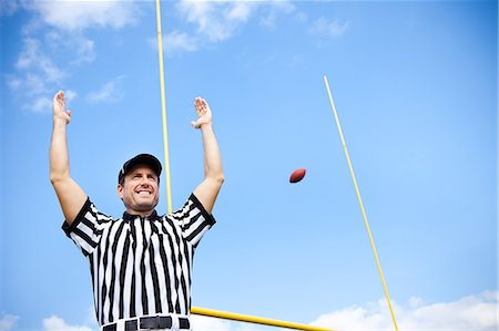 scoring - American Football Referee: Signalling a Touchdown Stock Photo - Premium Royalty-Free, Code: 6106-07455292