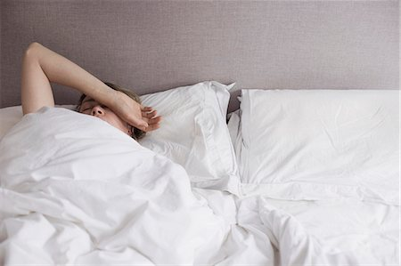 Woman in bed Stock Photo - Premium Royalty-Free, Code: 6106-07455220