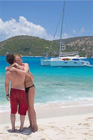 Couple hugging on the beach Stock Photo - Premium Royalty-Free, Code: 6106-07455364