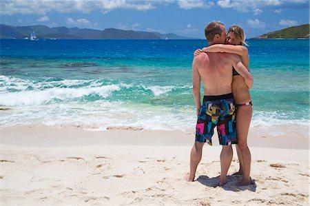 Couple standing on beach Stock Photo - Premium Royalty-Free, Code: 6106-07455454