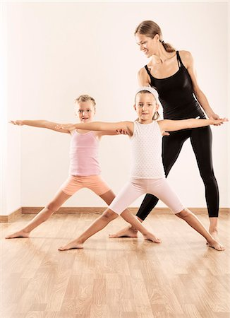 pantyhose kid - Yoga instructor teaching children Stock Photo - Premium Royalty-Free, Code: 6106-07455501