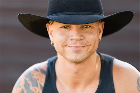 Happy cowboy with tatoos Stock Photo - Premium Royalty-Free, Code: 6106-07455672