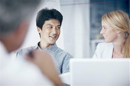 Office meeting Stock Photo - Premium Royalty-Free, Code: 6106-07493376