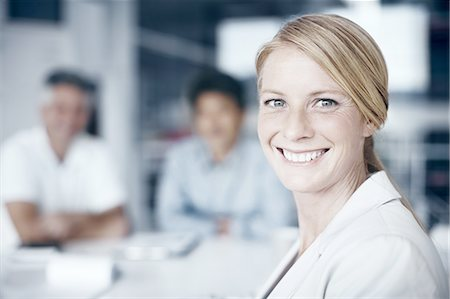Confident woman in a meeting Stock Photo - Premium Royalty-Free, Code: 6106-07493378