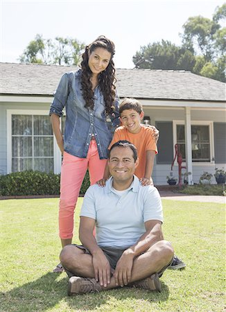 family shoes - Latino Family in Front of House Stock Photo - Premium Royalty-Free, Code: 6106-07493602