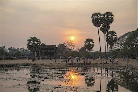Sunset at Angkor Wat, Cambodia Stock Photo - Premium Royalty-Free, Code: 6106-07493636