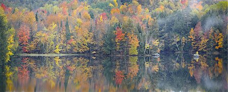 Fall Trees Reflecting into Lake Stock Photo - Premium Royalty-Free, Code: 6106-07493975