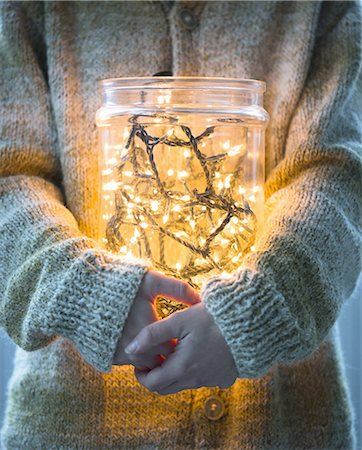 Woman with christmas lights in a jar Stock Photo - Premium Royalty-Free, Code: 6106-07594161