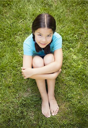preteen girl - Young girl sitting on the grass, portrait Stock Photo - Premium Royalty-Free, Code: 6106-07594820