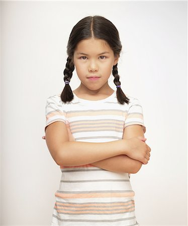 preteen girl pigtails - Sullen young girl in striped shirt, portrait Stock Photo - Premium Royalty-Free, Code: 6106-07594824