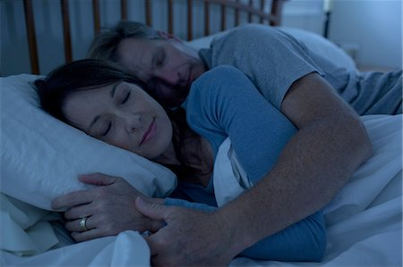 Middle aged woman and man sleeping in bed Stock Photo - Premium Royalty-Free, Code: 6106-07539242
