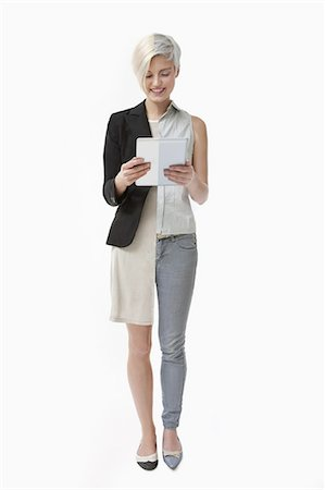 woman using computer tablet at home and at work Stock Photo - Premium Royalty-Free, Code: 6106-07539248