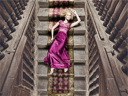 silky - Beautiful woman lying on a silk rug Stock Photo - Premium Royalty-Free, Code: 6106-07539413