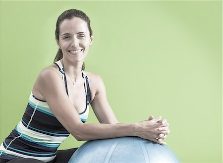 patterned - Woman with exercise ball Stock Photo - Premium Royalty-Free, Code: 6106-07602089