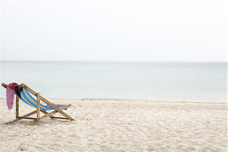 sunchair in the sand at the beach Stock Photo - Premium Royalty-Free, Code: 6106-07602197