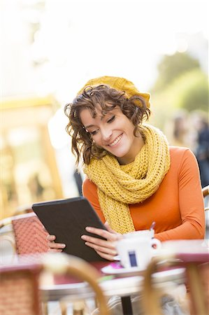 fall - A woman using a digital tablet Stock Photo - Premium Royalty-Free, Code: 6106-07602115