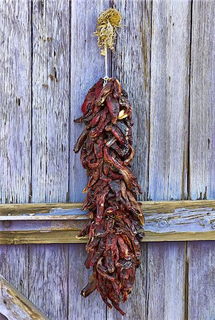 Dried Chili Peppers on Door Stock Photo - Premium Royalty-Free, Code: 6106-07602275