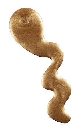 spill - A close up image of metallic gold nail polish. Stock Photo - Premium Royalty-Free, Code: 6106-07761824