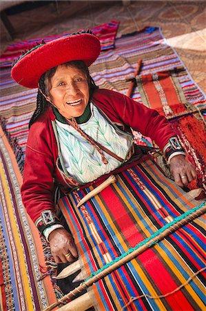 Peruvian woman weaving carpet, Sacred Valley Stock Photo - Premium Royalty-Free, Code: 6106-08057750