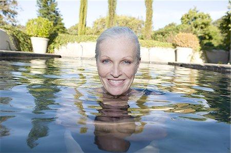 swimming - Mature woman in swimming pool Stock Photo - Premium Royalty-Free, Code: 6106-08057965