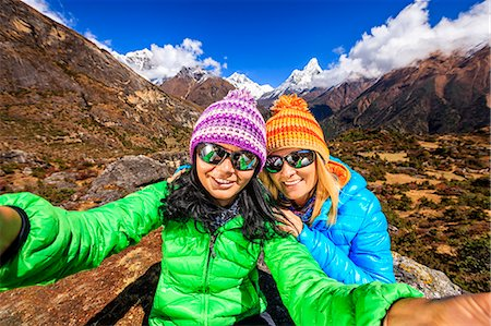 extreme terrain - Young women taking selfie in Himalayas Stock Photo - Premium Royalty-Free, Code: 6106-08080618
