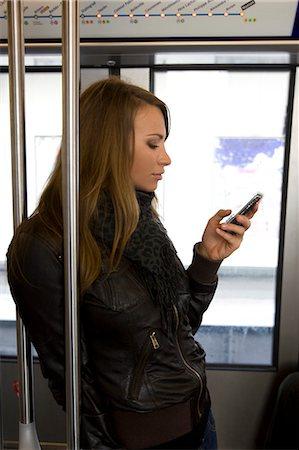 Woman at metro Stock Photo - Premium Royalty-Free, Code: 6106-08080768