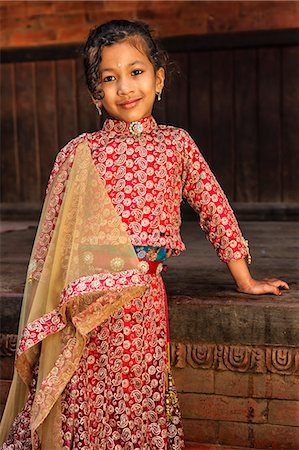 Young Nepali girl in traditional dress Stock Photo - Premium Royalty-Free, Code: 6106-08080810