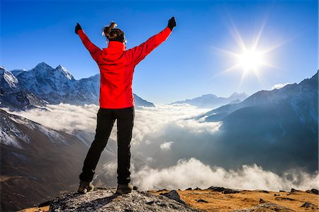 Woman lifts her arms in victory, Himalayas Foto de stock - Sin royalties Premium, Código: 6106-08080811