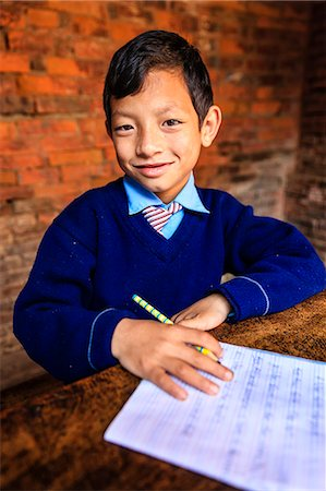 Young Nepali schoolboys in classroom Stock Photo - Premium Royalty-Free, Code: 6106-08080817