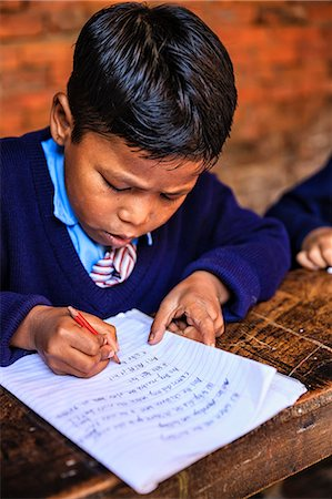 Young Nepali schoolboys in classroom Stock Photo - Premium Royalty-Free, Code: 6106-08080818