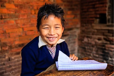 Young Nepali schoolboys in classroom Stock Photo - Premium Royalty-Free, Code: 6106-08080820