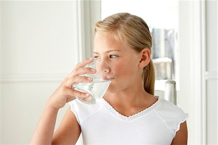 Girl drinking glass of water Stock Photo - Premium Royalty-Free, Code: 6106-08172078