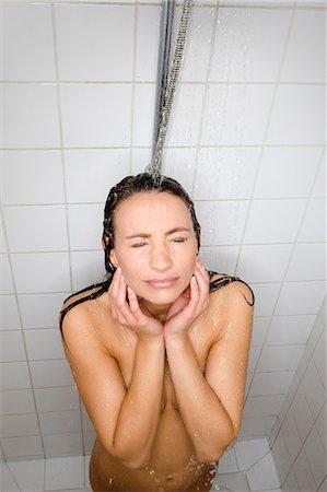 shower - Woman taking shower Stock Photo - Premium Royalty-Free, Code: 6106-08172141