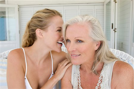 female - Mother whispering grandmother Stock Photo - Premium Royalty-Free, Code: 6106-08172153