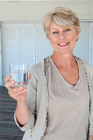 drinking water glass - Woman holding glass of water Stock Photo - Premium Royalty-Free, Code: 6106-08172261