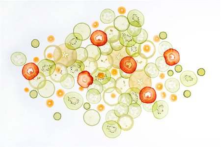 Thinly Sliced Vegetables and Fruits on Light Table Stock Photo - Premium Royalty-Free, Code: 6106-08172500