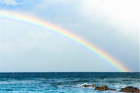 rainbow - A rainbow on the horizon of a tropical ocean Stock Photo - Premium Royalty-Free, Code: 6106-08181508
