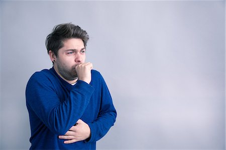 people coughing or sneezing - A middle aged man suffering from flu symptoms Stock Photo - Premium Royalty-Free, Code: 6106-08100294