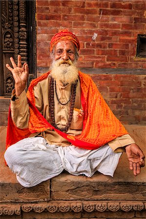Sadhu - indian holyman sitting in the temple Stock Photo - Premium Royalty-Free, Code: 6106-08100347