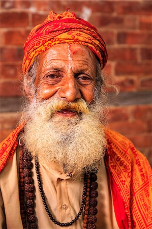 Sadhu - indian holyman sitting in the temple Stock Photo - Premium Royalty-Free, Code: 6106-08100348