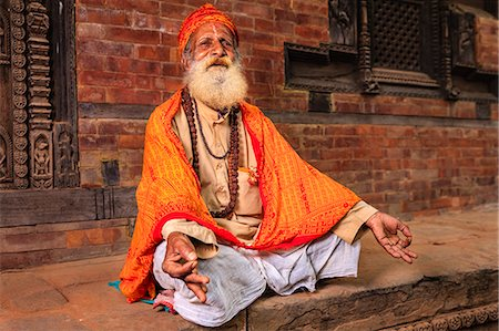 Sadhu - indian holyman sitting in the temple Stock Photo - Premium Royalty-Free, Code: 6106-08100350
