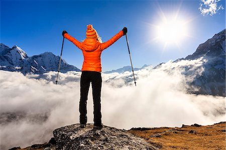 Woman lifts her arms in victory, Himalayas Stock Photo - Premium Royalty-Free, Code: 6106-08100365
