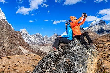 Two trekkers using laptop and tablet in Himalayas Stock Photo - Premium Royalty-Free, Code: 6106-08100376