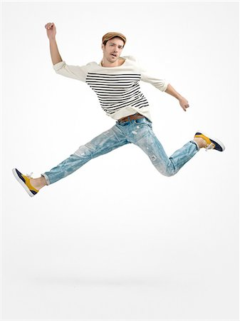 dancing - Young male jumping Stock Photo - Premium Royalty-Free, Code: 6106-08277431